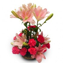 Pink lilies and carnations arranged in a basket