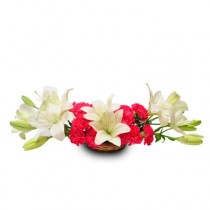 Basket arrangement of pink carnations and white lilies