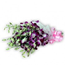 Elegant bunch of 10 purple orchids wrapped in cellophane with ribbon.