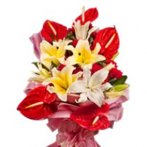 Bunch of red anthuriums, white oriental lilies and red carnations.